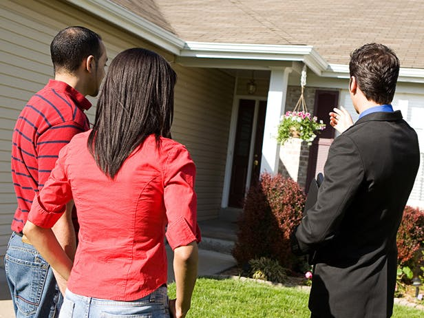 Real estate showing home to prospective buyers.