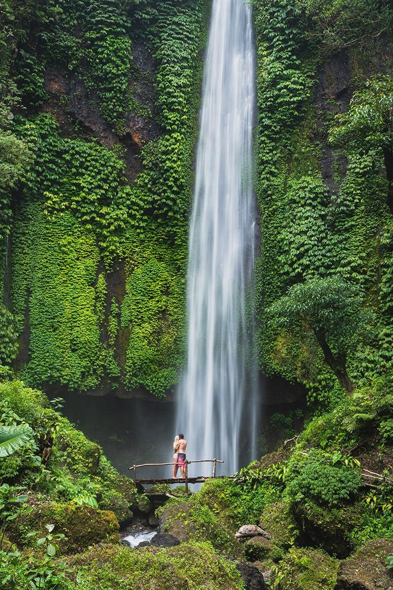 Underneath a waterfall in Bali