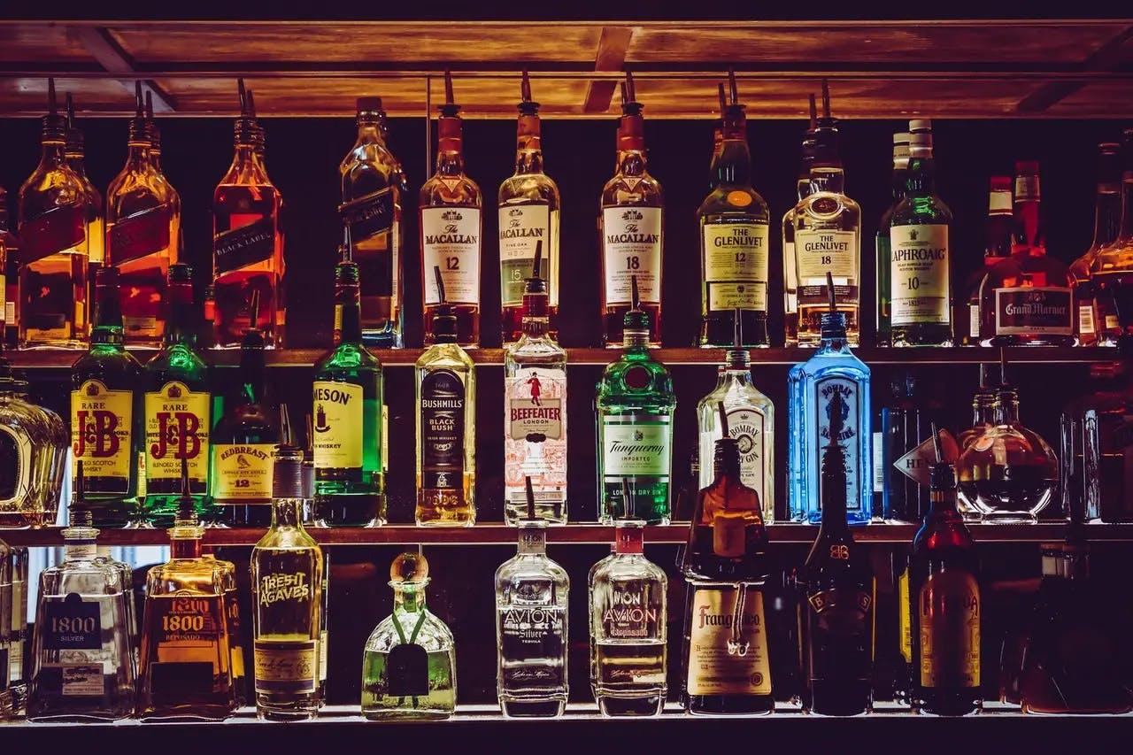 Rows of bottles on shelf