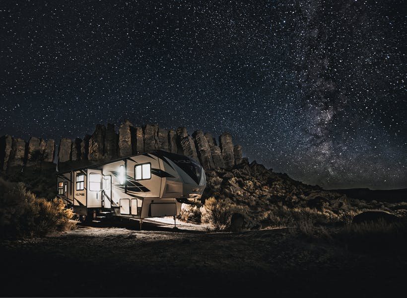 An RV under a starry sky