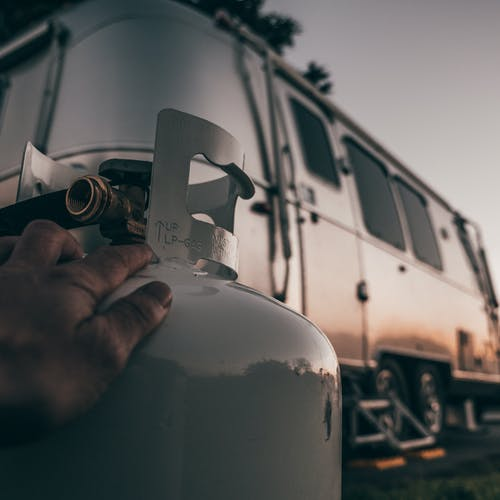 An Airstream trailer in sunset light