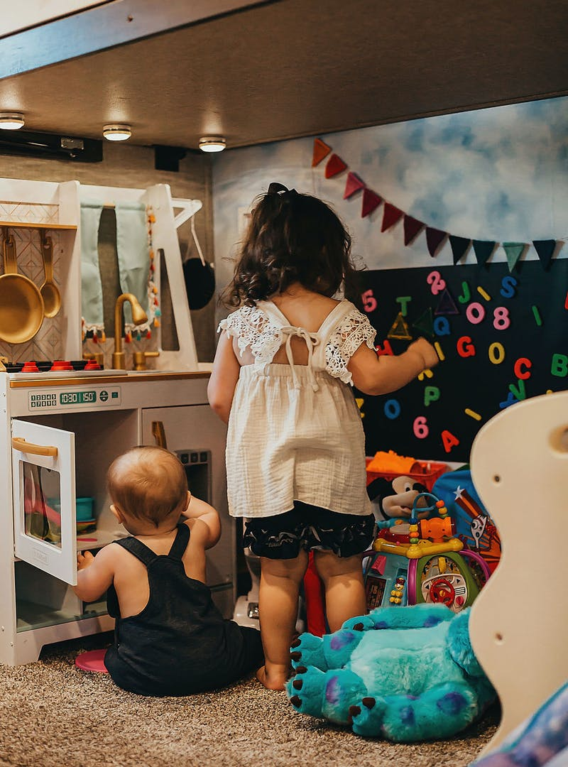 Sammy Seles' children play with their toys inside the family room of their Keystone Montana.