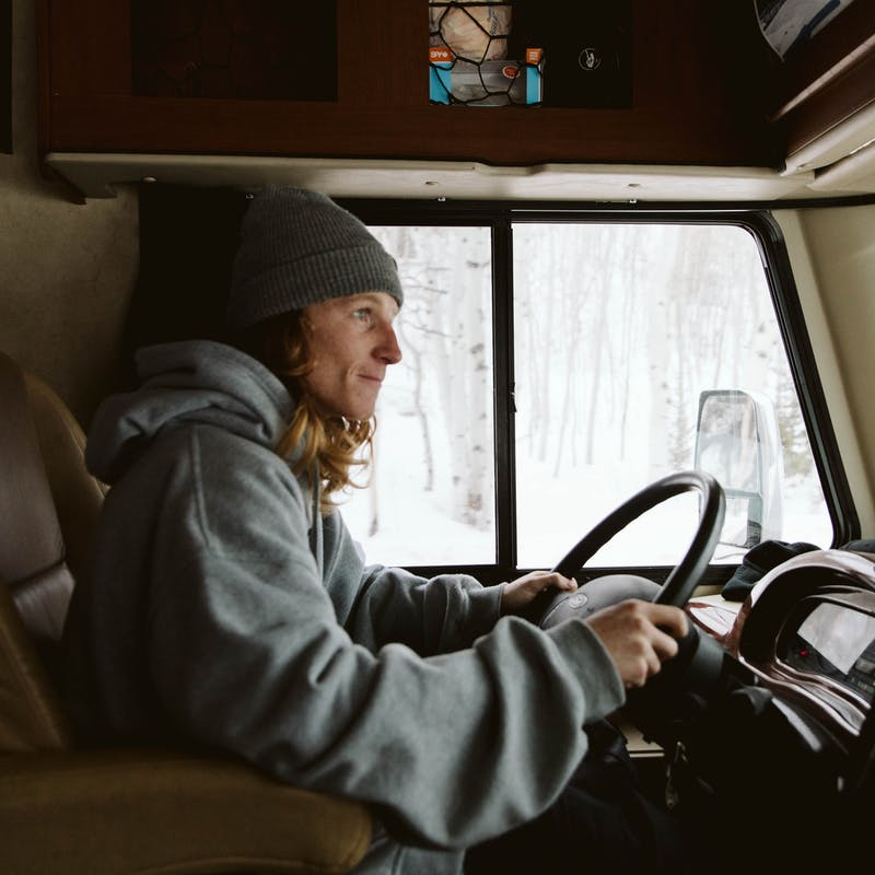 Ryan driving his RV through snow.