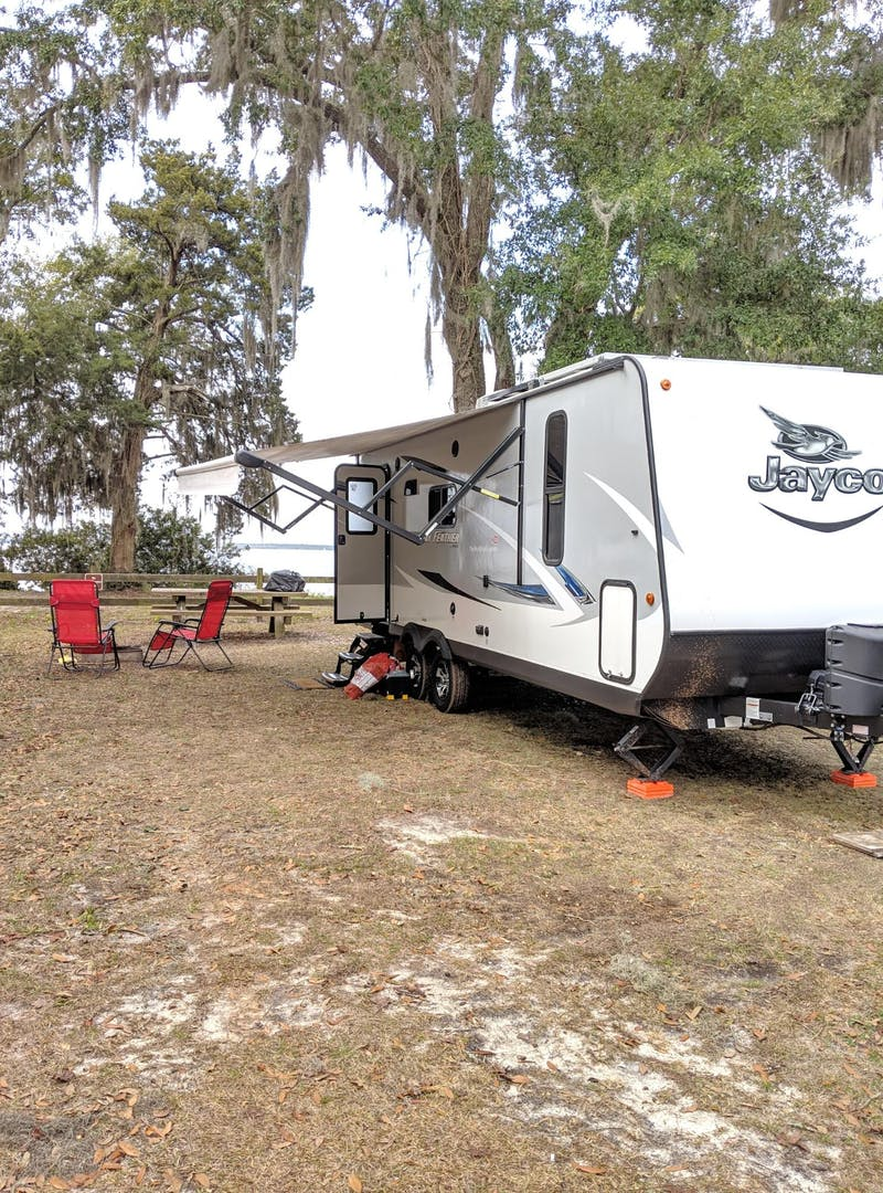 Ben and Christina McMillan's Jayco Jay Feather parked near the ocean in Florida.