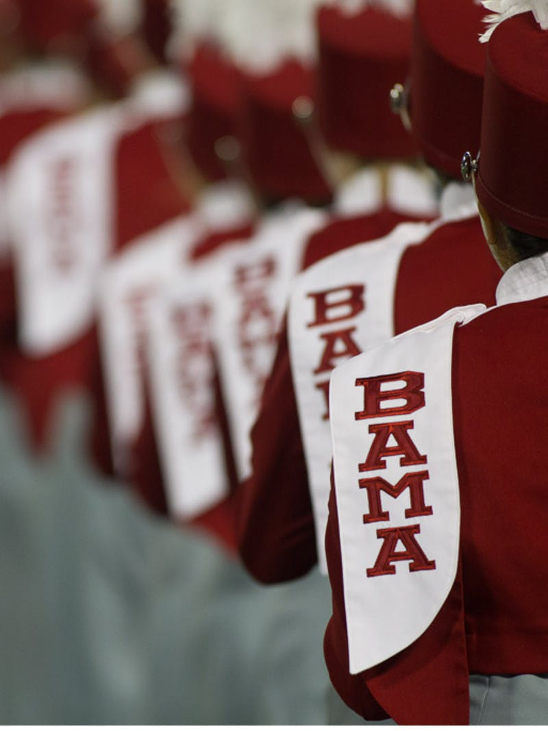 University of Alabama marching band, featuring Bama logo and crimson outfits from the back, in Tuscaloosa, Alabama.