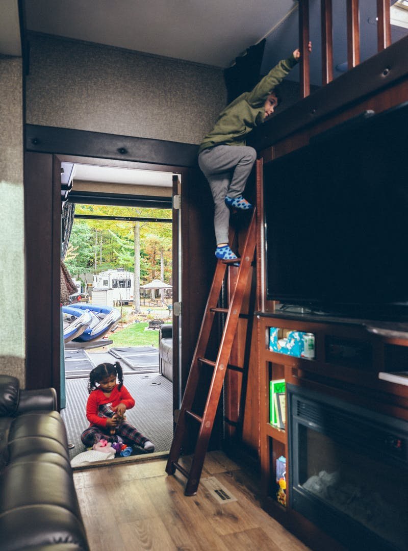 Julian climbing down from a bunkbed to go play outside.