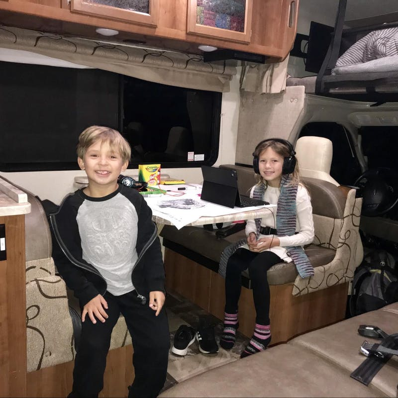 Raoul Martinez's children work and play at the dinette in a Thor Motor Coach Class C RV.