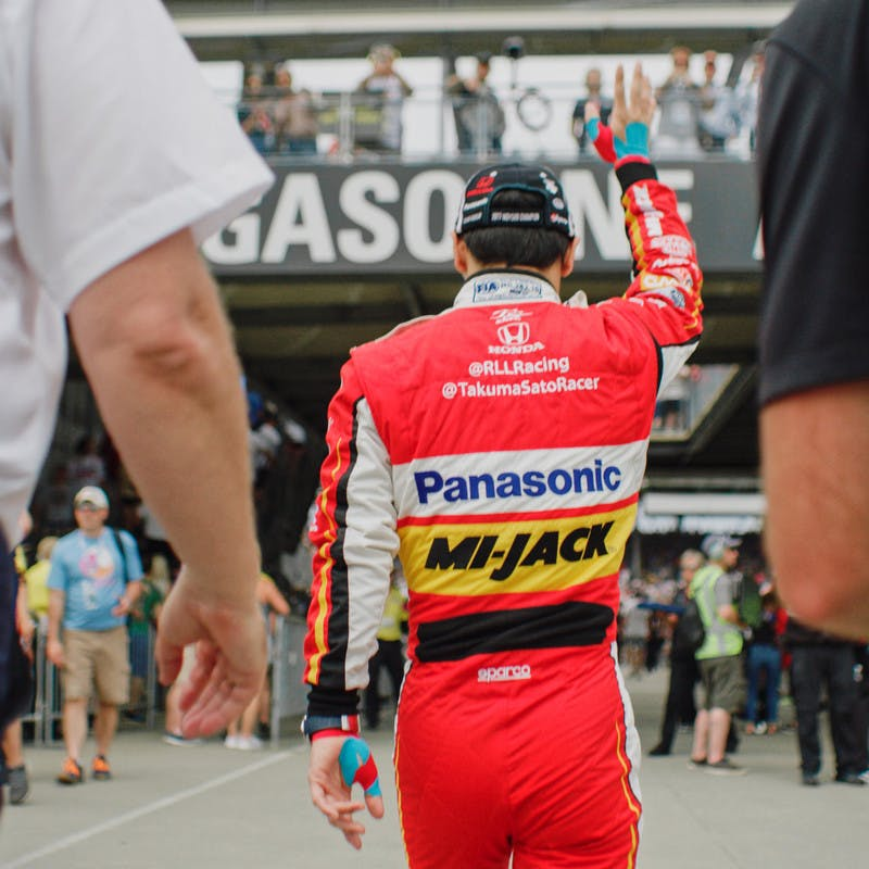 Takuma Sato waves to fans at the 2019 Indy 500.