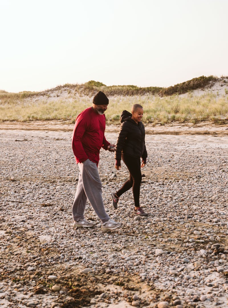 Sonya Lowery and Ray Young taking a walk on the beach in Cape Cod.
