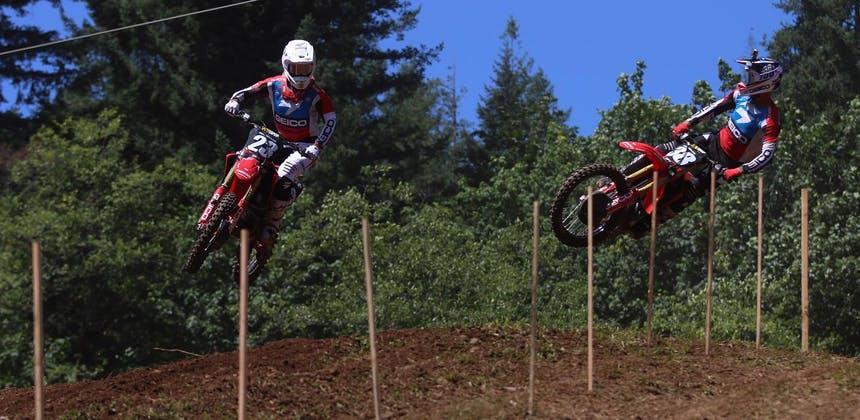 Two dirt bike riders getting air at Washougal Motocross Park.