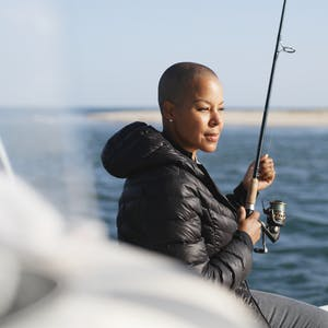 Sonya Lowery holding a fishing pole on a deep sea fishing trip in Cape Cod.