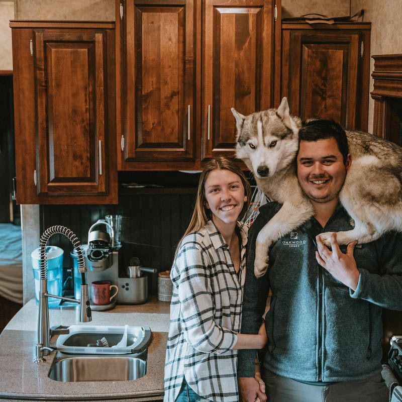 Jessica Shaw and her boyfriend Nico, with a husky on Nico's shoulders