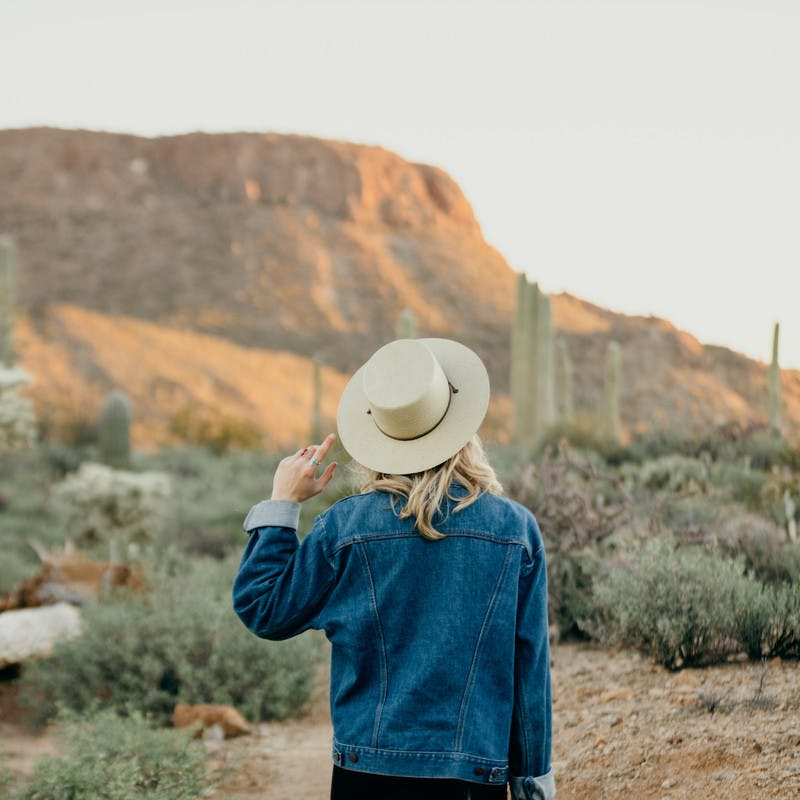 Image of Natalie Allen looking out into the open desert.