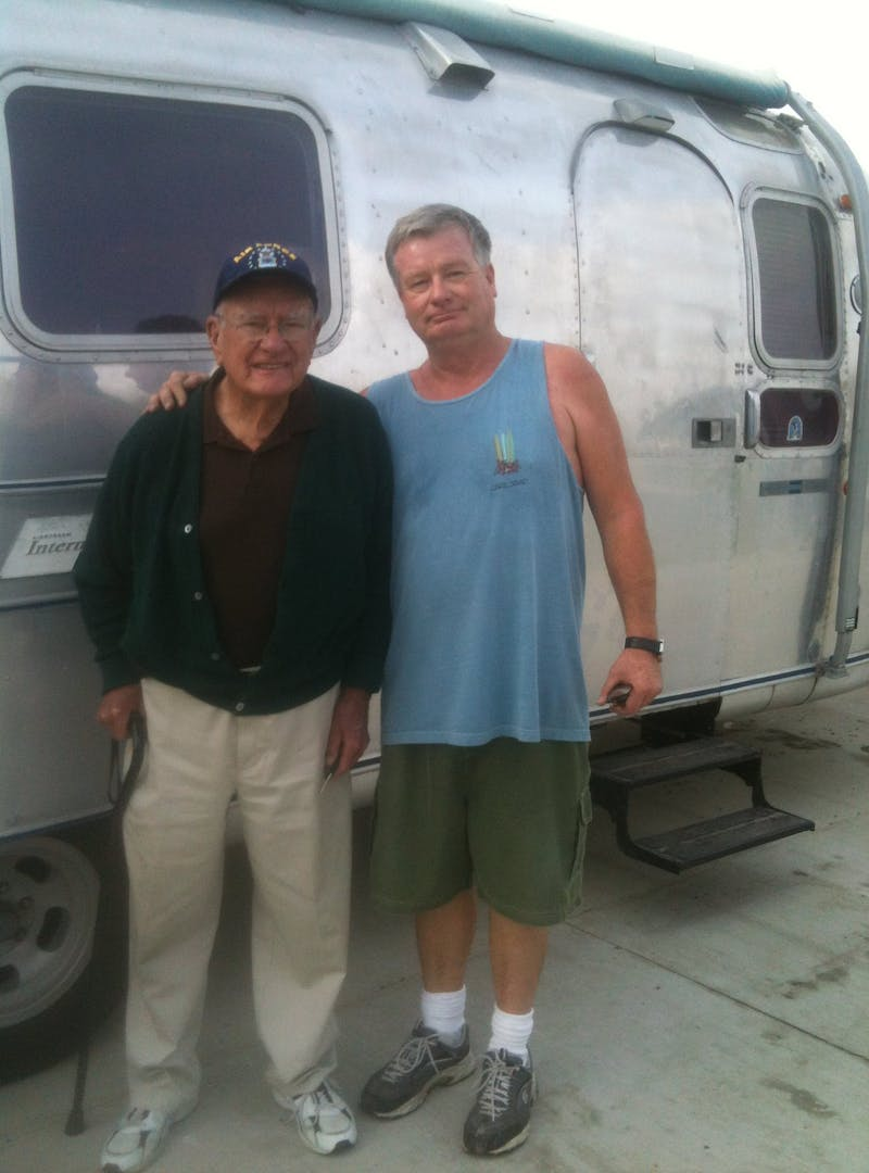 Bill Hartig standing with his elderly father in front of the Airstream.