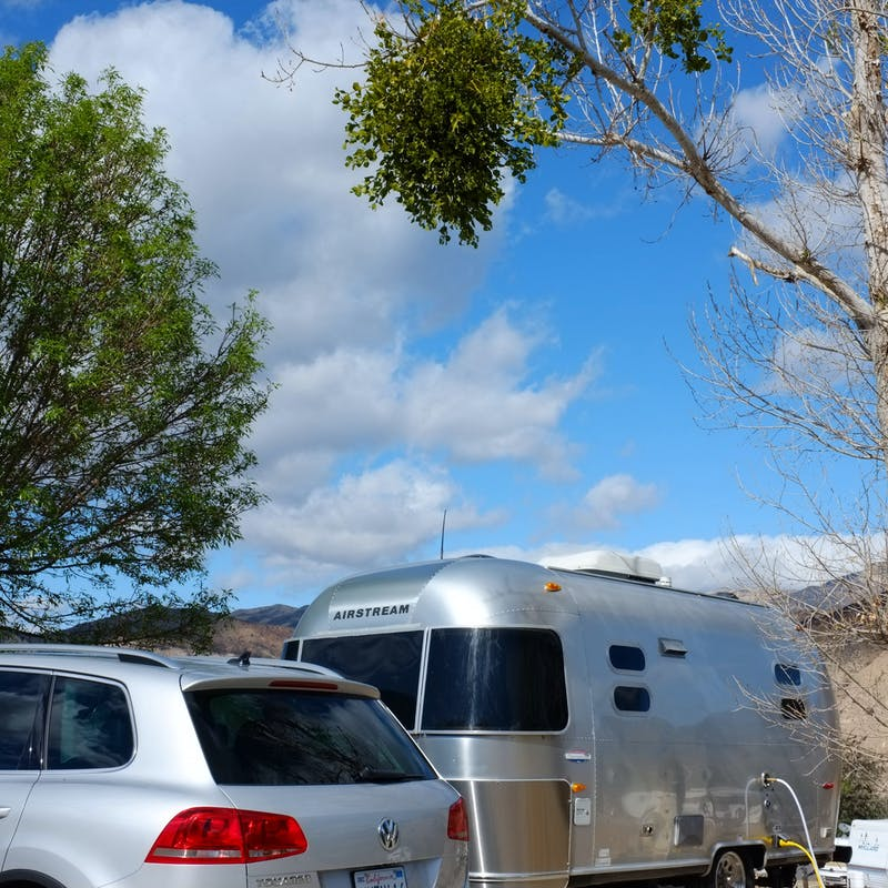 Dr. Na's Airstream parked at a campsite.
