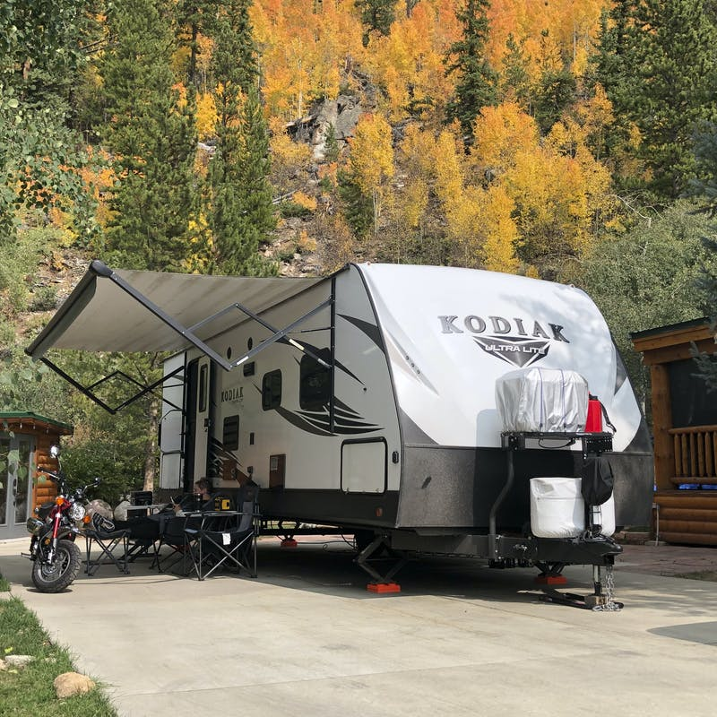 Abby Booth's Kodiak travel trailer parked at a campsite.