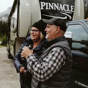 Tina and Craig Klinefelter in front of their RV.