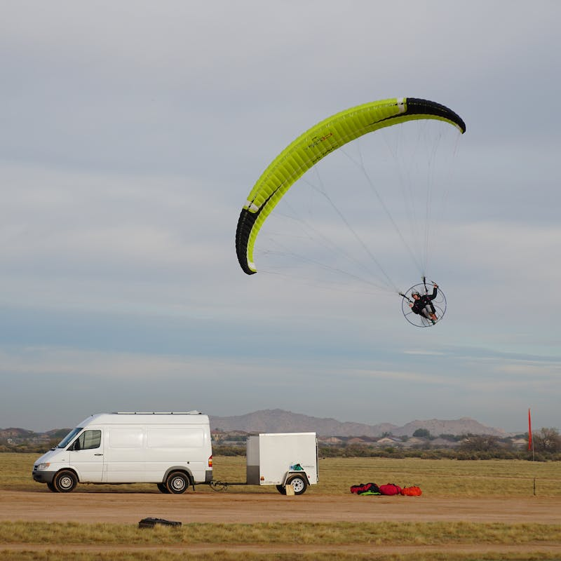 Tucker Gott takes off the ground on his paramotor.
