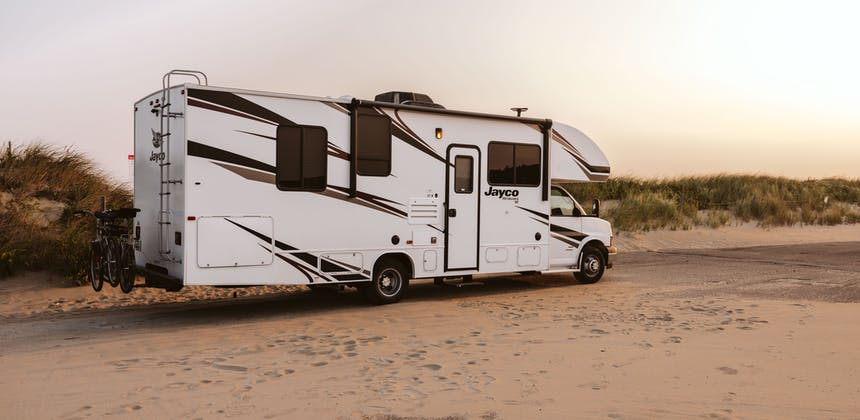 Sonya Lowery's Jayco Redhawk parked by the ocean.