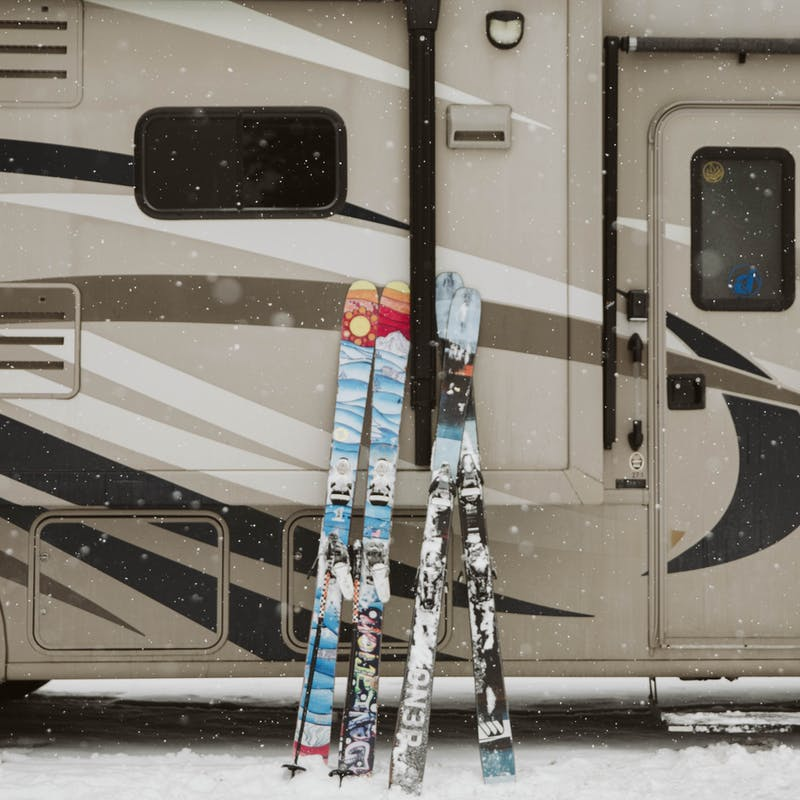 Two sets of skis outside Ryan's RV.