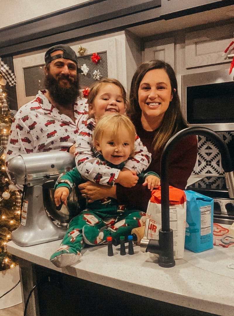 Sammy Seles' family smile for a photo inside of the kitchen of their Keystone Montana.