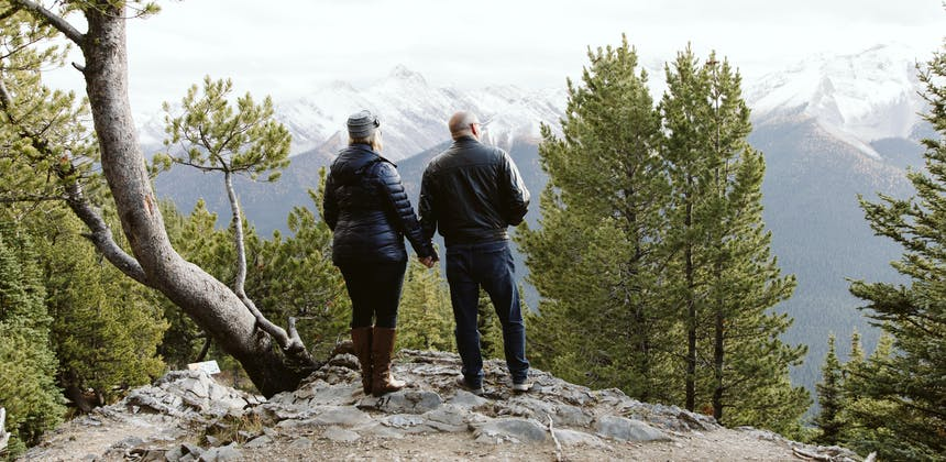A couple admiring the mountain scenery.