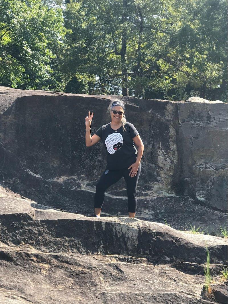 Kirsten Womack poses during a hike at Flat Rock park in Columbus, Georgia.