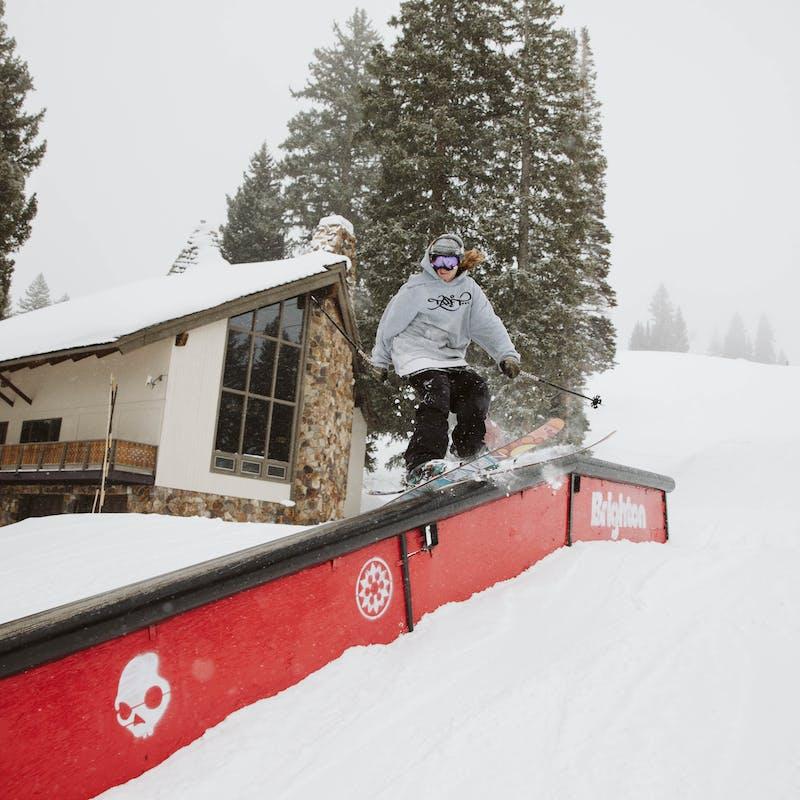 Ryan skiing down a rail.