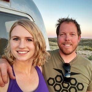 Anna and James posed for a photo in the desert.