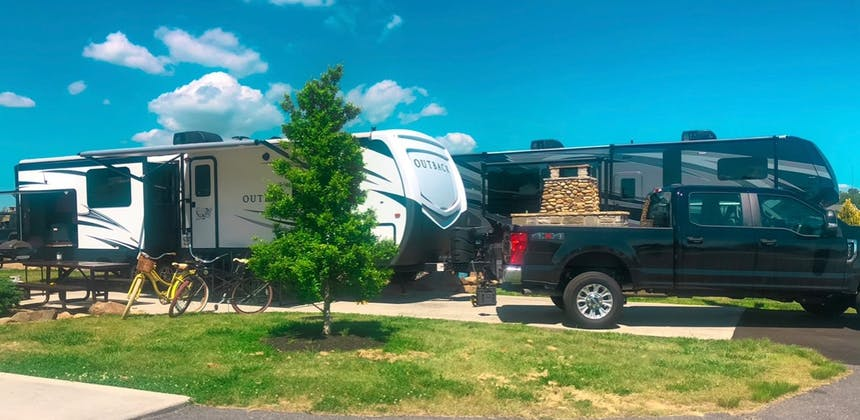A travel trailer RV parked at a campsite