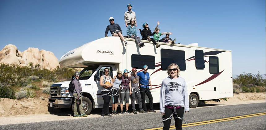 First Descents cancer young adult group in front of Jayco Redhawk RV in Joshua Tree