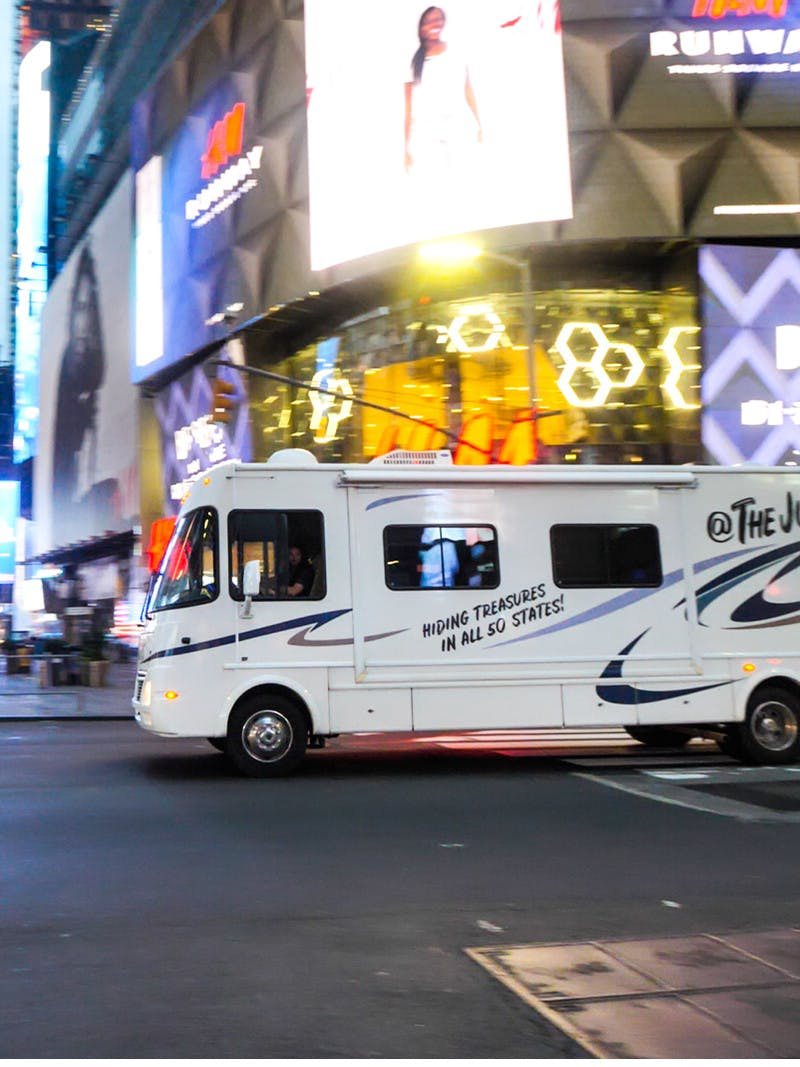 The Jurgy's Class A Thor motorhome driving through the streets of Times Square in New York City.