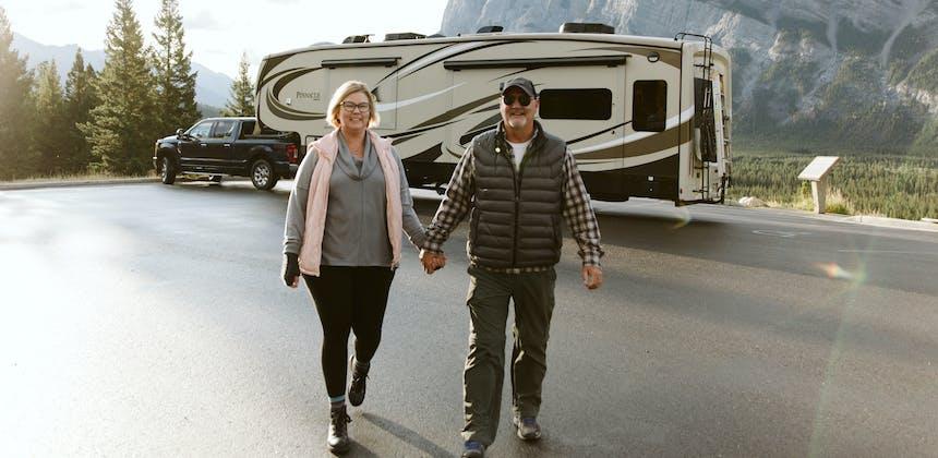 Tina and Craig walking around a campground together.