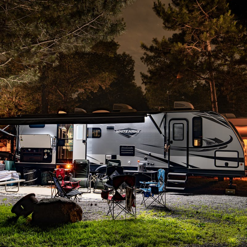 Bill Sferrazza's Jayco RV parked at night at a campsite.