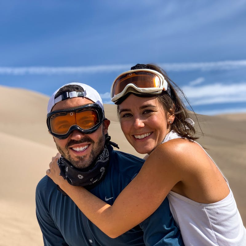 Dawn hugs Jason as they post for a picture in Great Sand Dunes National Park.