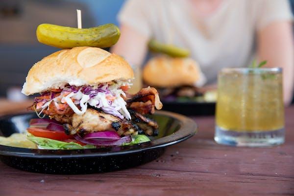 A close up shot of a BBQ chicken sandwich.
