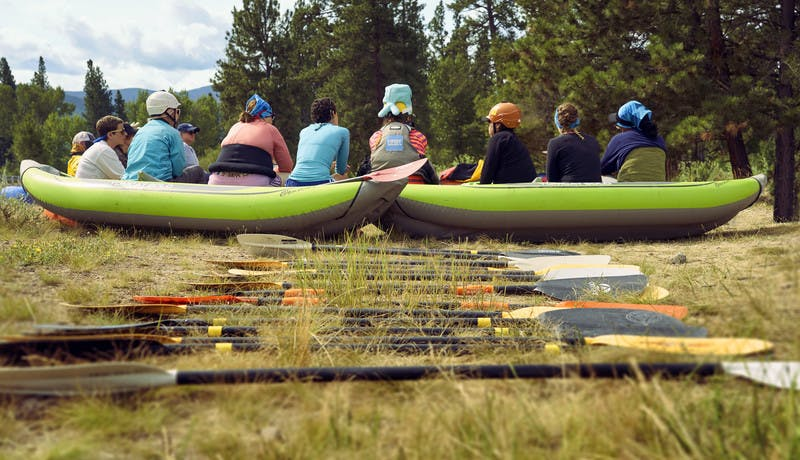 Participants sit during a training on how to kayak.