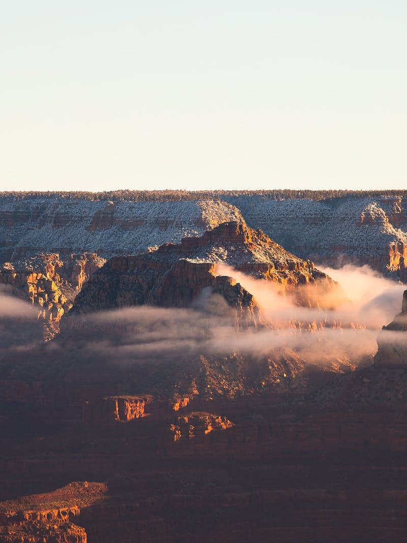 Sunset view of the Grand Canyon with clouds through the rocks
