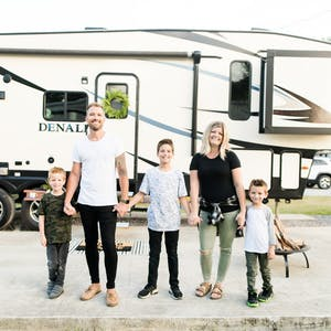 The Cutler family posed in front of their RV for a portrait.