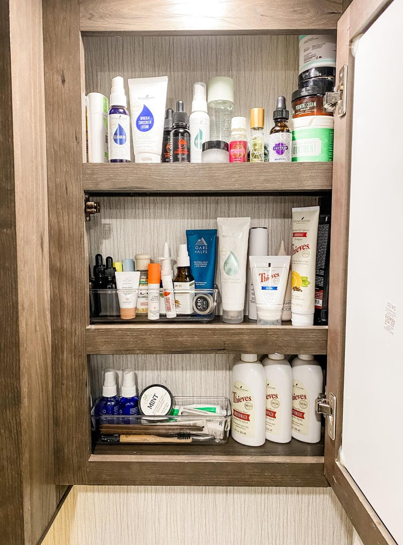 Small items organized in bins within the bathroom medicine cabinet of Brittnee Proha's Heartland Cyclone.