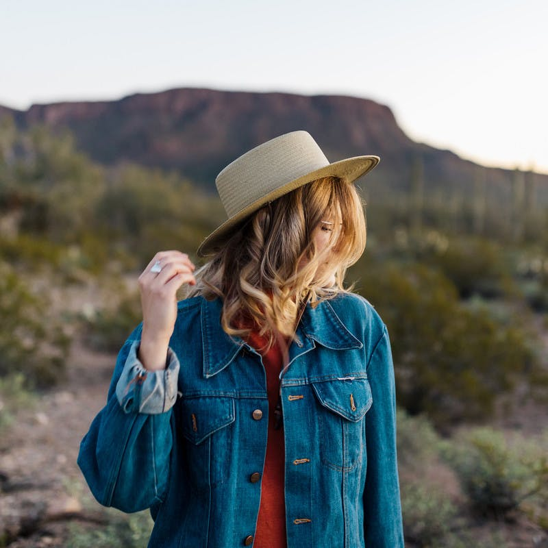 Close up shot of Natalie Allen looking off in the distance of a desert.