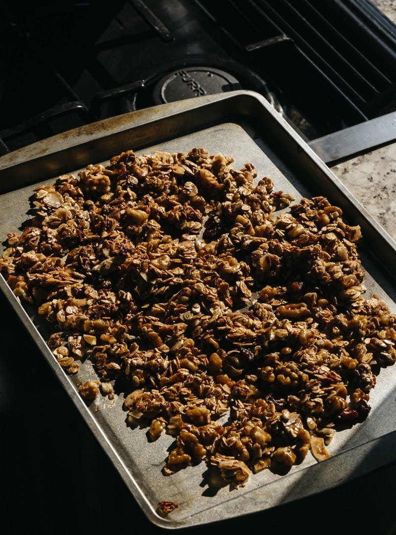Baking sheet filled with homemade granola.