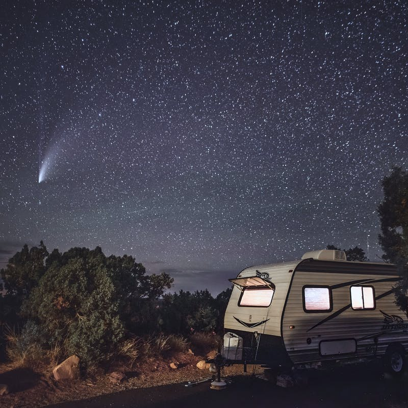 the NEOWISE comet flashes through the sky with Alison Takacs's Jayco RV in the foreground.