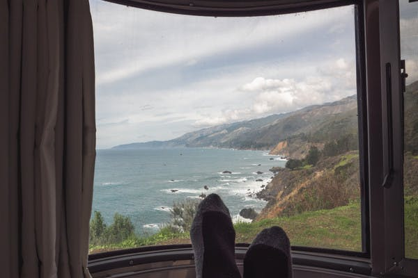 A view of the Big Sur coastline, looking out from an RV window.