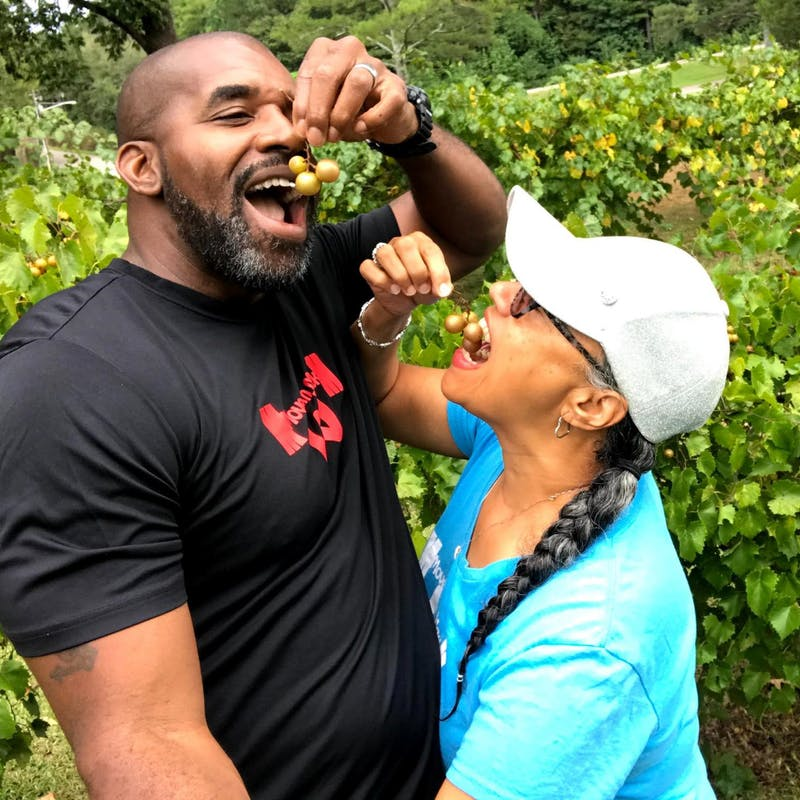 Kirsten Womack and her husband pick grapes and eat them at a park in Leesburg, Alabama.