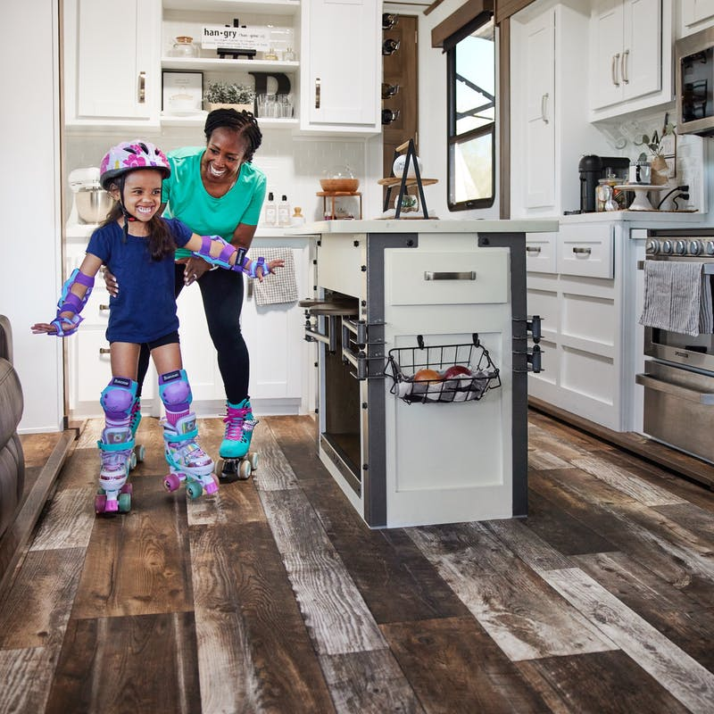 Robin and holds onto her granddaughter as they roller skate around the kitchen of a Keystone Fuzion.