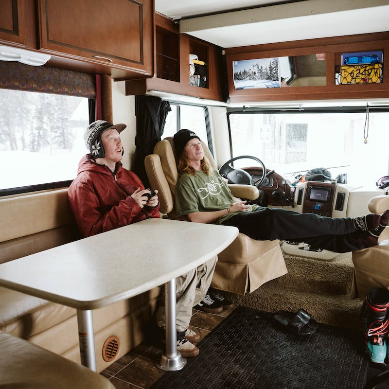 Ryan and a friend kicking back inside his RV after a long day.