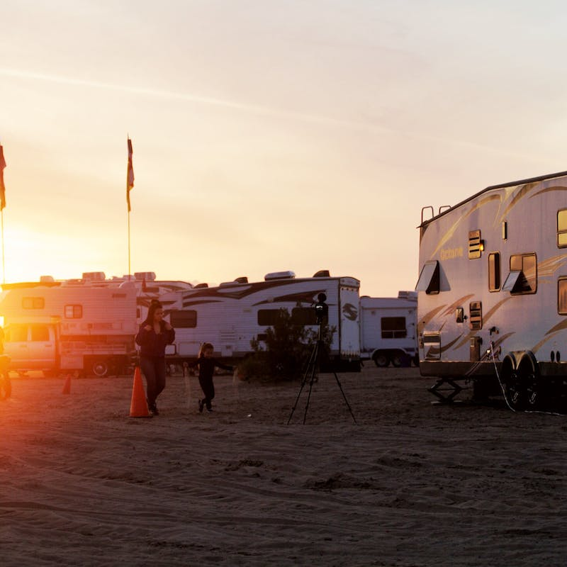 The sun setting over RVs parked at Glamis.