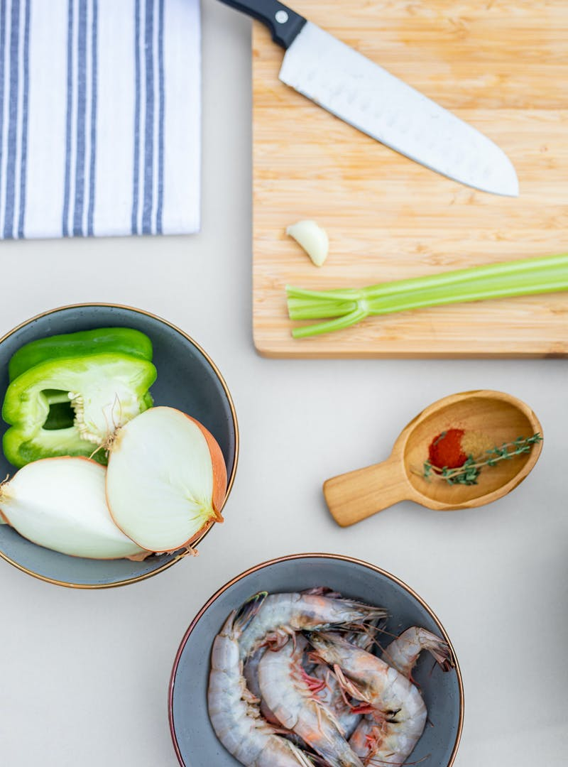 Prepping onion, green pepper, celery and shrimp for the recipe.