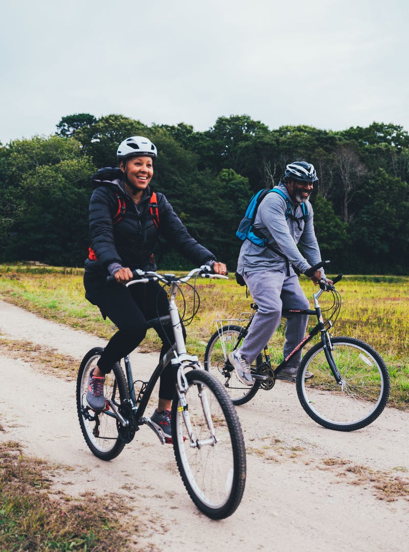 Sonya Lowery and Ray Young on a bike ride through a cranberry bog.